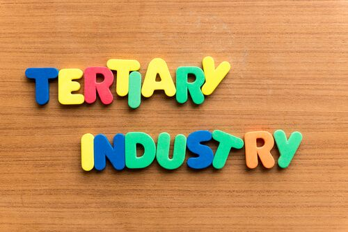 tertiary industry colourful word on the wooden background