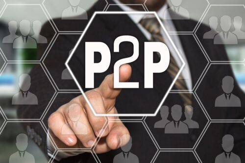 business man clicking to p2p button on virtual screen
