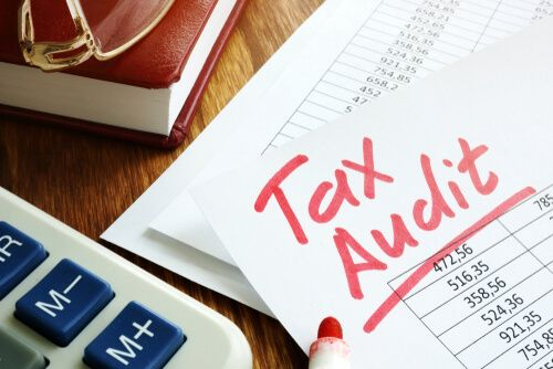 Tax audit handwriting on business accounting documents.