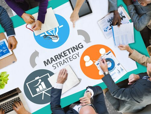 group of people doing marketing strategy meeting
