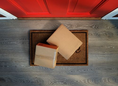 Delivered to the door, e-commerce purchases on welcome mat