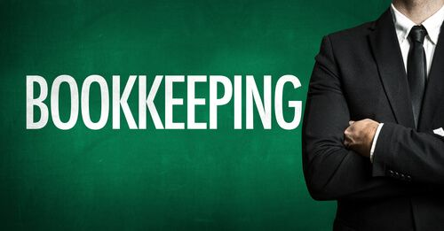 business man standing with Bookkeeping written on a green background