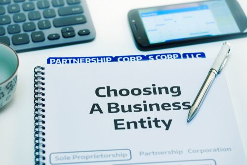 Startup company desk reviewing the different types of business entities