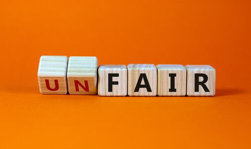 Turned a cube and changes words 'unfair' to 'fair' with orange background