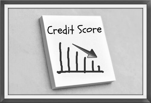 text credit score on the graph goes down on the short note texture background