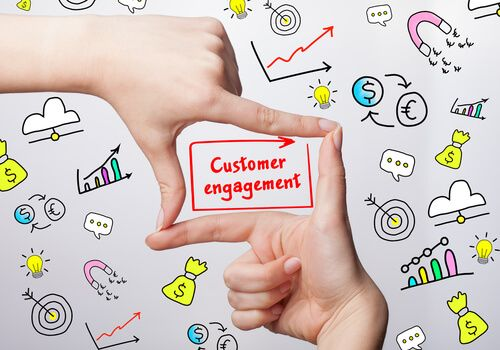 business woman writing word: Customer engagement