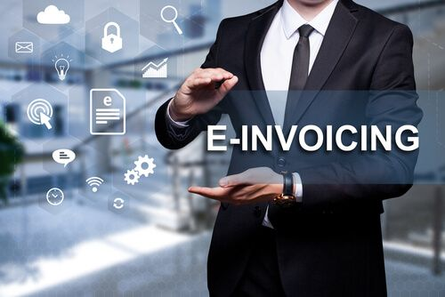 """White icon with text """"E-Invoicing"""" in the hands of a businessman"""