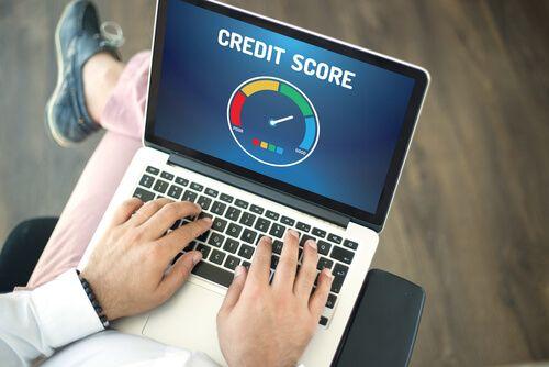 man using laptop for checking CREDIT SCORE