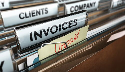 Close up on a file tab with the word invoice