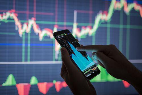 Businessman checking stock market data on mobile
