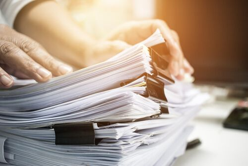 man placing documents in table